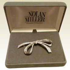 Nolan Miller Silver Tone Metal Clear Sparkling Rhinestone Bow Brooch