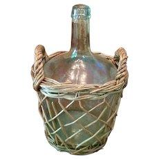 French Demijohn In Hand Woven Basket