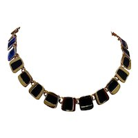 Gold Tone Black Enameled Flexible Length Necklace.