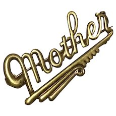 Gold Tone Mother Brooch