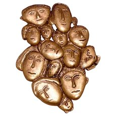 Many Faces Gold Tone Brooch