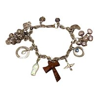 Sterling Silver Charm Bracelet With Various Charms