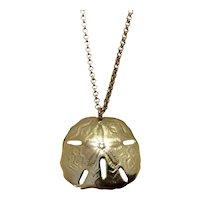 Gold Tone Sand Dollar Pendant Necklace