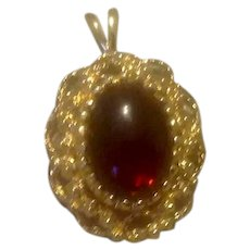 Gold Tone Filigree Red Glass Stone Pendant