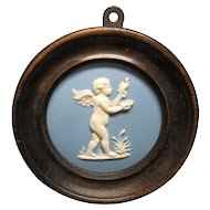 Antique Early 19th century Wedgwood Pale Blue Jasperware Framed Plaque of a Cherub