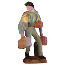 Continental French Art Deco Porcelain Figure of a Traveling Salesman Carrying Suitcases and Wearing a Jockey Cap