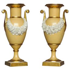Pair Antique Early 19th century French Empire Dagoty Old Paris Porcelain Vases or Urns with Bisque Floral Swags on an Apricot Ground Enhanced by Gilding