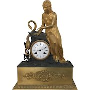 Antique Early 19th century French Empire Gilt & Patinated Bronze Figural Mantel Clock Depicting Eve with a Serpent