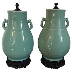 Pair Chinese Art Deco Monochrome Celadon Porcelain Vase Urns with Stylized Loop Handles Mounted as Table Lamps with Carved Wood Bases