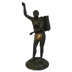 Antique 19th century Bronzed Spelter Blackamoor Figure Representing America from the Continents Wearing a Feather Skirt and Carrying a Basket on Her Back