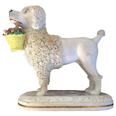 Large and Important 19th century English Regency Antique Staffordshire Pearlware Dog by John & Rebecca Lloyd of Shelton Figure of a Poodle Carrying a Basket of Fruit in its Mouth 1840