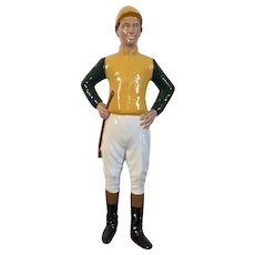 Vintage Heavy Iron Desk Top Statue of a Lawn Horse Jockey Dressed in Silks, Cap, Jodhpurs, Boots and Carrying a Riding Crop Mounted on Mahogany Base Door Stop