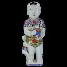 Antique 18th century Chinese Kangxi Porcelain Figure of a Ho Ho Boy Holding a Vase with Child at His Feet in Famille Rose Palette