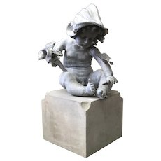 Lead Garden Statue Ornament of a Putto or Cherub Emblematic of Peace with the Devices of War Including a Torch and Helmet on Sandstone Base