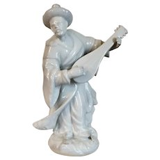 Continental Blanc de Chine White Porcelain Malabar Figure of a Chinese Musician or Mandarin Dressed in Flowing Robes and Playing the Mandolin