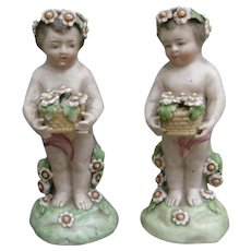 Pair Antique 18th century English George III Chelsea Derby Porcelain Figures of Cherubs, Putti or Children Holding Baskets of Flowers