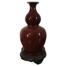 Antique Late 18th / Early 19th century Chinese Monochrome Oxblood Sang de Boeuf Double Gourd Vase on Fitted Carved Wood Stand