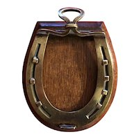 Antique 19th century English Equestrian Themed Desk Paper Clip in the Form of a Brass Horse Shoe on Oak Base