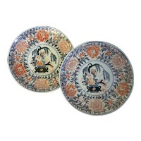 Pair Antique 19th century Japanese Porcelain Plates Decorated with Flower Baskets in an Imari Palette