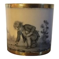 Antique 18th century French Empire Paris Porcelain Dihl et Guerhard Coffee Can Cup Decorated with a Boy at Play en Grisaille on an Apricot Ground 1790 - 1800
