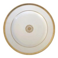French Empire Paris Porcelain Round Platter or Charger Decorated with Gold Flower Head on White Ground Early 19th century