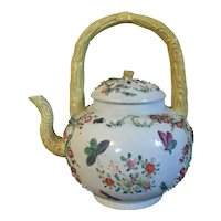 Fine Antique 18th century Chinese Export Qianlong Porcelain Tea Pot or Punchpot in Famille Rose Palette with Faux Bois Handle and Painted with Butterflies and Appliqué Flowers circa 1780