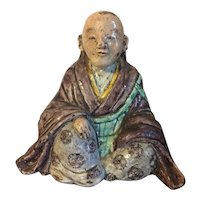 Antique 18th / 19th century Japanese Tokugawa Edo Pottery Figure of a Priest or Scholar in the Buddha Pose