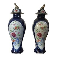 Pair Antique 18th century Chinese Qianlong Famille Rose Baluster Shape Tobacco Leaf Vases or Jars with Foo Lion Finials in Powder Blue