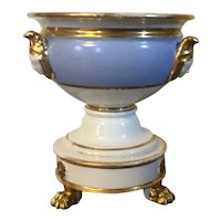 Antique 19th century Paris Porcelain Urn with Lion Paw Feet, Caryatid Mask Handles and Flower Head Ornaments
