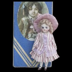 "4 1/2"" (11cm) Antique French All Bisque All original Mignonette Doll in Presentation Box with trousseau"