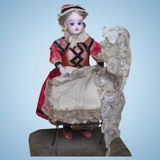 "12"" (30cm) Charming Antique French Mechanical Toy Nanny Gaultier Doll Rocking the Cradle, in original presentation, working condition, c.1875"