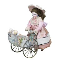 Rare Antique French Mechanical Toy Walking doll with Carriage and Two mignonettes by Vichy, c.1875