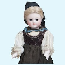 "6 1/2"" (17cm) Rare Antique German All-Bisque Doll by Kestner with Fancy Ankle Boots, closed mouth and original costume, c.1880"