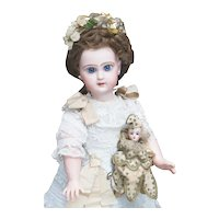 """17 1/2"""" (45cm) Antique French Jumeau bebe Reclame doll with closed mouth, original dress, size 7, c.1892"""