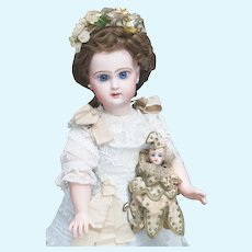 "17 1/2"" (45cm) Antique French Jumeau bebe Reclame doll with closed mouth, original dress, size 7, c.1892"