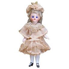 "4 1/4"" (11сm) Antique French All-Bisque Mignonette Doll,  Original dress, c.1885"