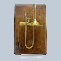 Antique Brass Trombone Desk Clip Mounted on Wood Base, English