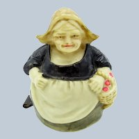 Antique Dutch Woman with Basket Celluloid Tape Measure