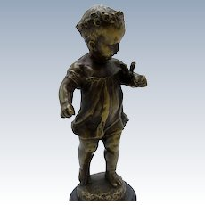 Antique Child Bronze in Nightdress Playing with Butterfly