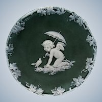 Antique Jasper Ware Green and White Cherub with Umbrella and Bird