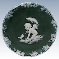 Antique Jasper Ware Green and White Cherub with Umbrella and Bird