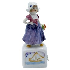 Antique Germany Porcelain Dutch Girl Standing on Box with Boat Tape Measure