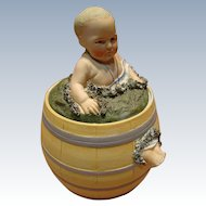 Porcelain Heubach Quality Figure of Child Seated in a Barrel
