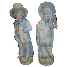 """Cute Pair of Antique Bisque Figurines of Boy and Girl Playing """"Dress Up"""""""