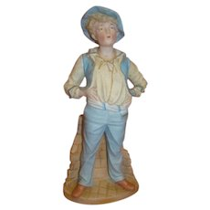 12 In. Bisque Figurine of a Cheerful Whistler Boy