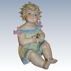 Large Smiling Piano Baby Girl Seated, Intaglio Eyes, Dimples, Holding Gold Luster Cup, Fly Away Separately Molded Curls