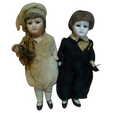 Adorable Completely Original 4-1/4 In. Pair of Early German All Bisque Wedding Couple, Wigged, Glass Eyes, Closed Mouths, Peg Jointed