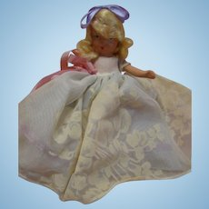 Nancy Ann Storybook Doll in Original, Never-Played-With Condition, Jointed Arms, Stiff Legs, Flocking on Dress, Lavender and Pink Ribbons