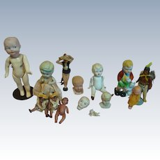 Lot of 14 Misc Bisque and Celluloid Dolls, Mostly Made in Japan, 1 German A.M. Googly