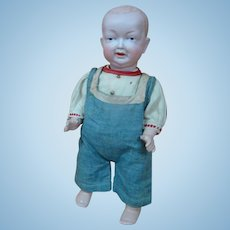11 In. Bisque Head German Character Toddler with Sideways Grin and Open/Closed Mouth